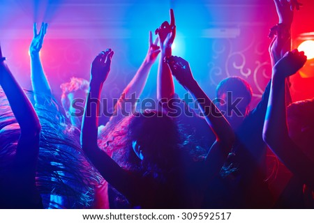 Energetic crowd partying all night long - stock photo