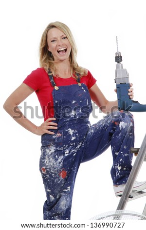 Energetic woman with drill - stock photo