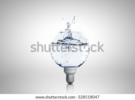 Energy and ecology concept with light bulb with water inside - stock photo