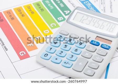Energy efficiency chart and calculator - studio shot - stock photo