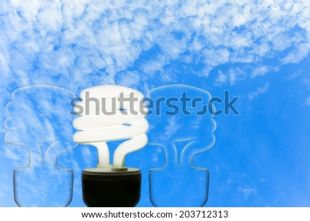 Energy efficient light bulb on blue sky - stock photo