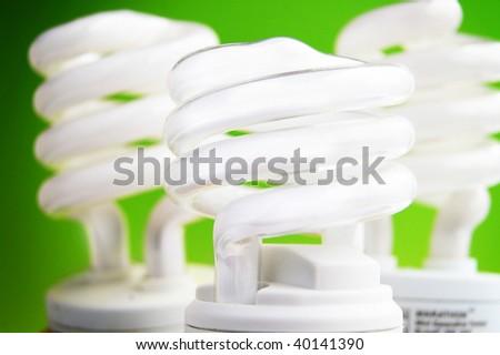 energy efficient light bulbs on green background - stock photo