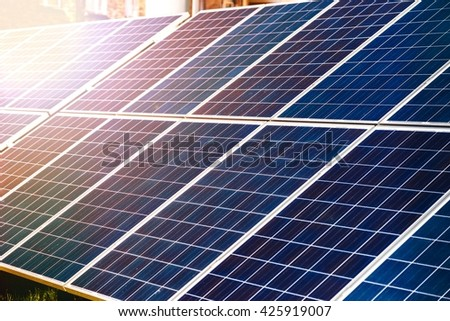 Energy-efficient solar panels producing electricity - stock photo