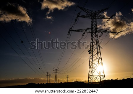 Energy Electricity Power Pylon on a Blue Sky - stock photo