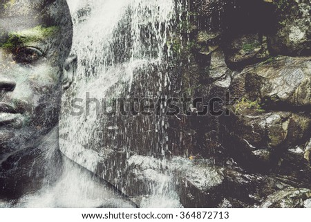 Energy inside him. Digitally composed half full face picture of handsome young African man over the picture of waterfall - stock photo