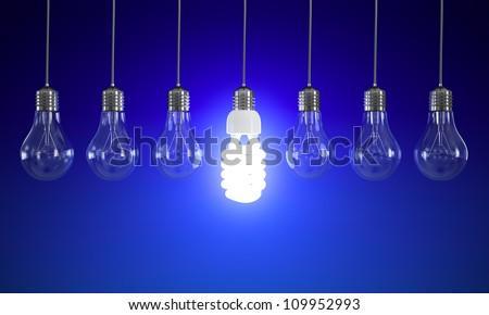 Energy saving and simple light bulbs isolated on blue background. - stock photo