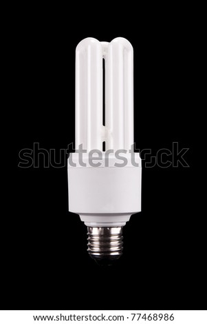 energy saving bulb on black background - stock photo