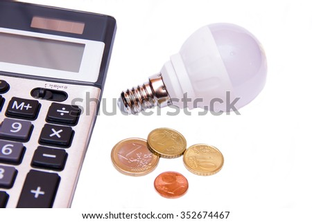 Energy saving light bulb and money on white background - stock photo