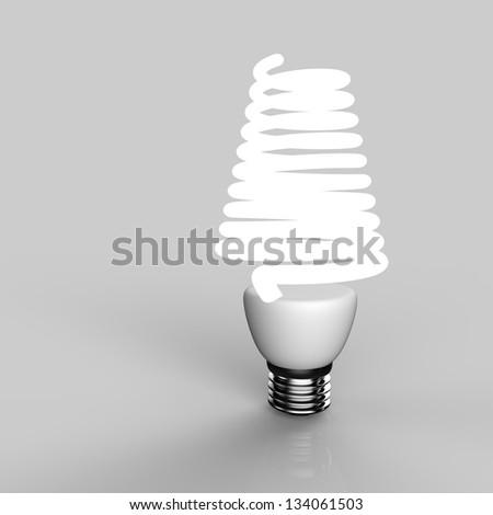 Energy saving light bulb close up in studio. - stock photo