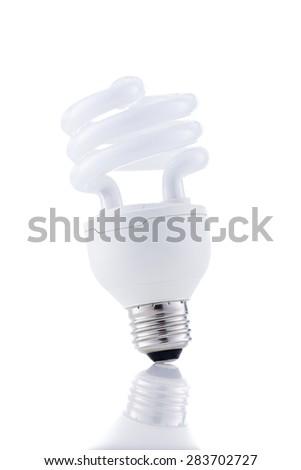 Energy saving lightbulb isolated on white background - stock photo