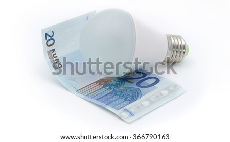 Energy saving - money. Led light bulb on the 20 of euro on a white background - stock photo