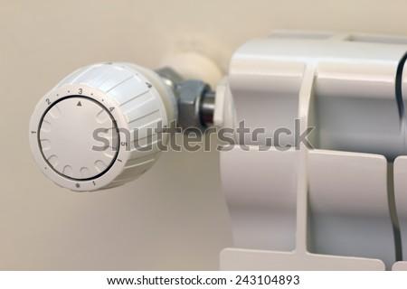 Energy saving with temperature regulating thermostatic valve - stock photo