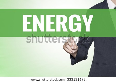 Energy word on green virtual screen touching by business woman - stock photo
