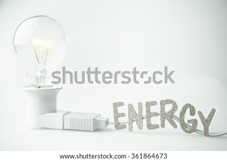 energy word on wire and light bulb for energy concept - stock photo