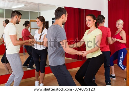 Energy young couples dancing active dance in class. Selective focus