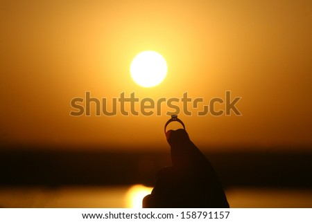 engagement ring at sunset, Sunrise over Red Sea in Egypt - stock photo