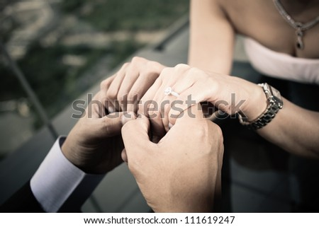 engagement ring, bride and groom hands close up ring - stock photo