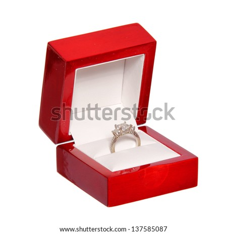 engagement ring in gift box red isolated on white background. wedding - stock photo