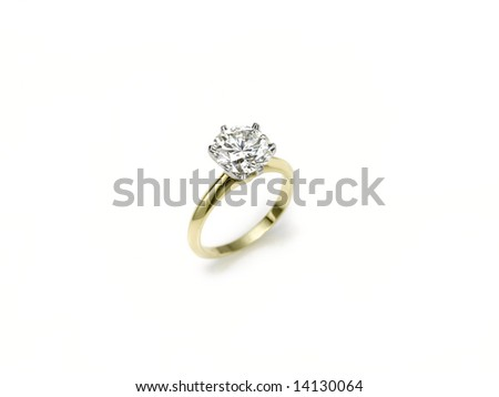 engagement ring standing on white - stock photo