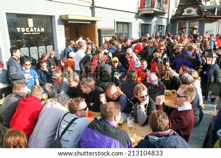 Engelberg, Switzerland - 8 April 2006: People drinking on a restaurant after skiing at Engelberg on the Swiss alps - stock photo