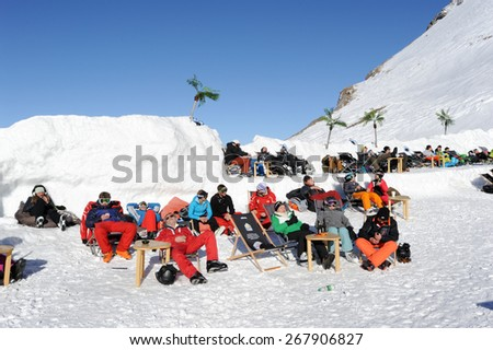 Engelberg, Switzerland - 18 February 2015: Ski tourists drinking and eating at the restaurant on mount Titlis over Engelberg on the Swiss alps - stock photo