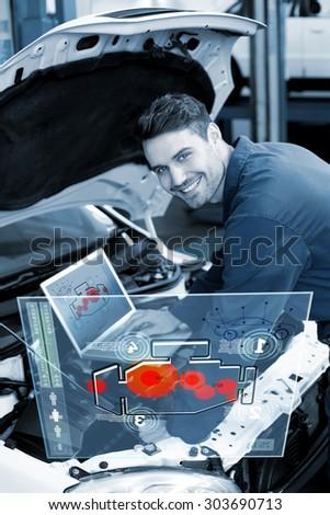Engine interface against mechanic using laptop on car - stock photo