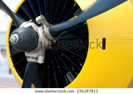 Engine of an old yellow aircraft - stock photo
