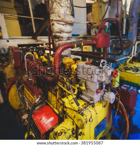 Engine Room on a cargo boat ship interior, ship's engine heavy Machinery Space - Pipes, Valves, Engines, oil rig platform interior  - stock photo