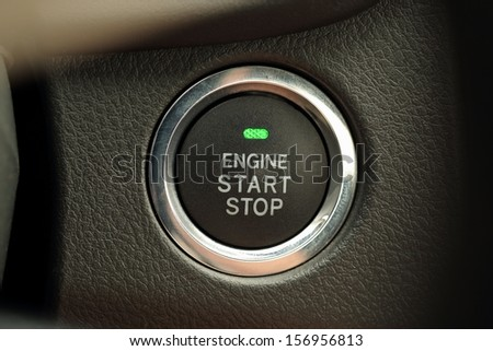 Engine start stop button of a car - stock photo