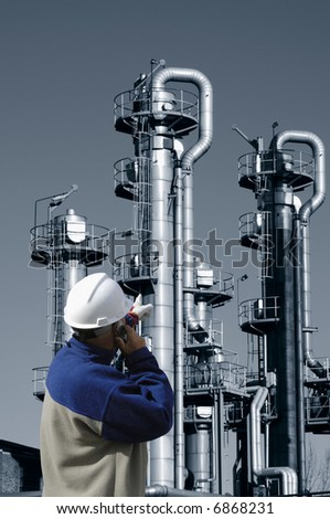 engineer and oil and gas refinery in duplex blue toning - stock photo