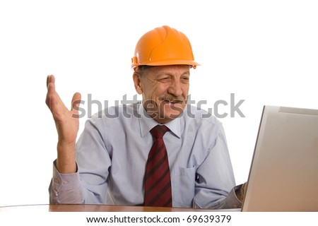 Engineer at the computer isolated on white background - stock photo