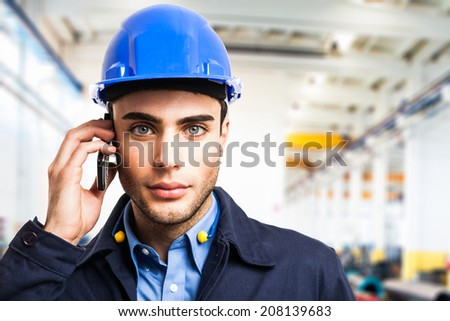 Engineer at work in a factory - stock photo