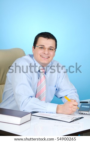 Engineer at work on blue background - stock photo