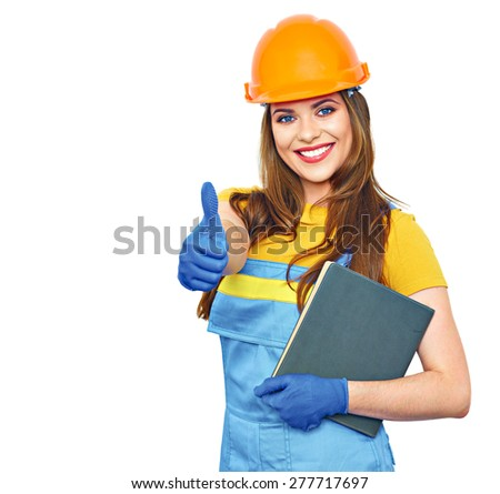 Engineer builder woman smile, hold business paper, show thumb. Builder uniform coveralls. Orange protective helmet. - stock photo