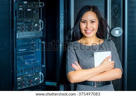 Engineer businesswoman in network server room - stock photo