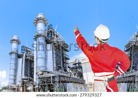 Engineer control working at equipments and machinery with modern thermal power plant in refinery - stock photo