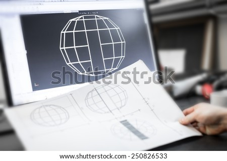Engineer desk with construction projects and computer aided design program CAD with displayed sketch. - stock photo