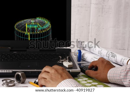 Engineer doing a 3d model review in his tank design - many uses in oil & gas industry. - stock photo