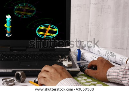 Engineer doing a model review in his design - many uses in oil & gas industry. - stock photo