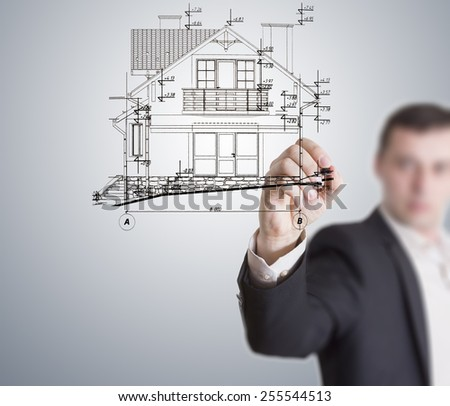 Engineer, draw the building plan on the glass table. - stock photo