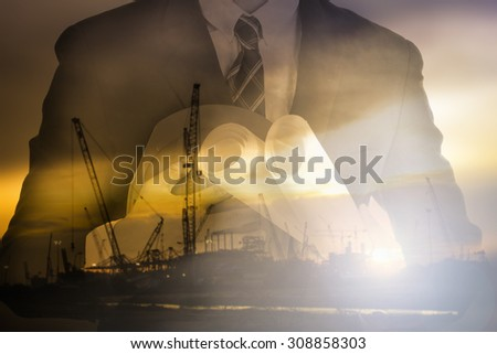 Engineer holding Safety hat with twilight time on Labor Day ,double exposure  - stock photo