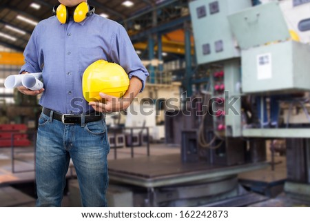 Engineer in the area of the factory. - stock photo