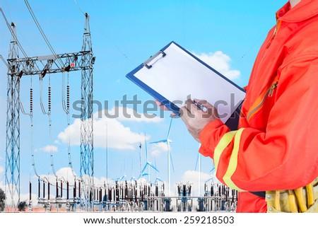 engineer maintaining record power plant station by wind turbine power generator  - stock photo