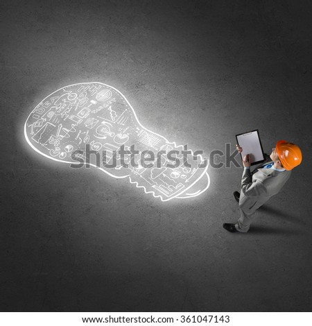 Engineer man and his business strategy - stock photo