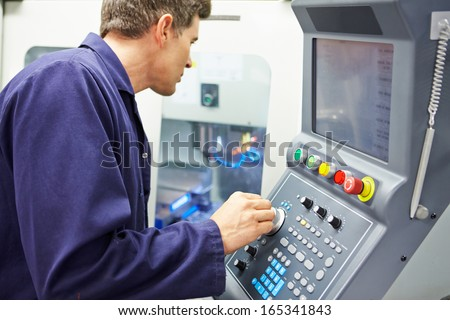 Engineer Operating Computer Controlled Milling Machine - stock photo