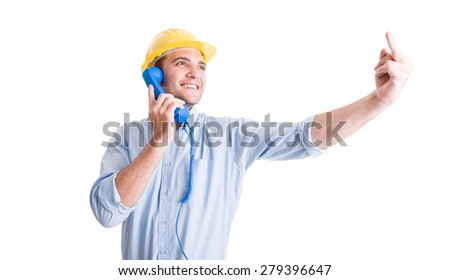 Engineer or architect showing middle finger while talking on the phone - stock photo