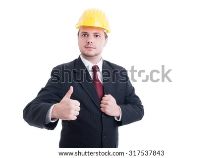 Engineer or architect wearing suit, tie and hardhat showing like gesture - stock photo