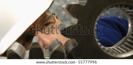 engineer, physicist studying the geometry of gears, close-ups - stock photo