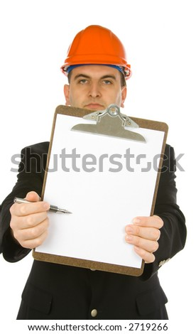 engineer pointing with a pen on a blank paper attached to clipboard - stock photo