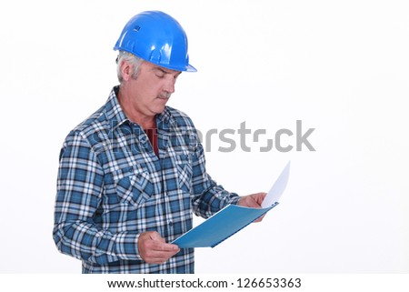 Engineer reading a report - stock photo